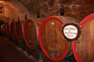 The wine is aged in oak barrels in the cellar of the underground city.